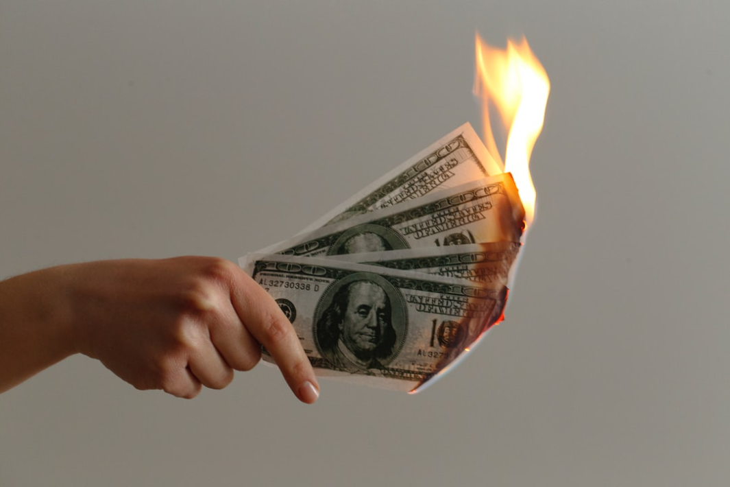 Burned 100 US Dollar Banknotes